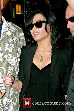 Demi Lovato actress and singer-songwriter leaving her Manhattan hotel while wearing a black dress New York City, USA - 23.07.09