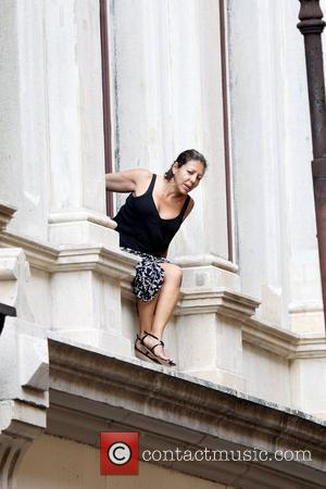 An avid fan watching the film set action below Viola Davis and Julia Roberts on the set of their upcoming...