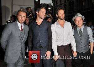 Gary Barlow, Jason Orange, Howard Donald and Mark Owen of Take That GQ Men Of The Year Awards held at...