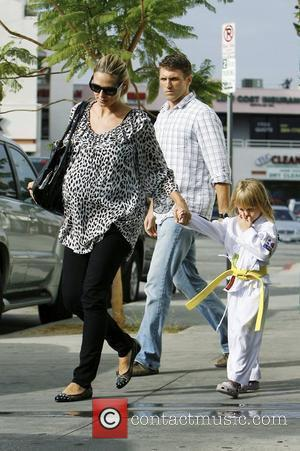 Heidi Klum and Leni A very pregnant Heidi Klum picks up her three children from a martial arts school in...