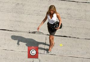 Butler And Aniston Holding Hands?