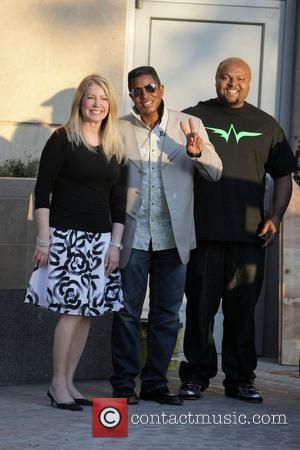 Jermaine Jackson and Damon Elliott visit a luxury condo open house at The Carlyle in Westwood.  Los Angeles, California...