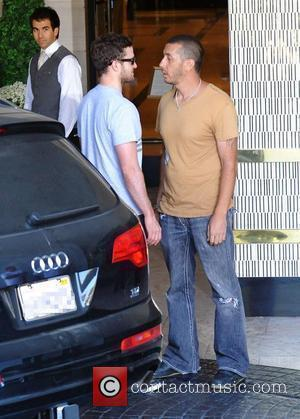 Justin Timberlake is harassed by an aggressive paparazzi as he arrives at his hotel Los Angeles, California - 14.07.09