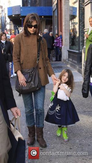 Katie Holmes, daughter Suri Cruise walking through New York, on their way to Balthazar restaurant New York City, USA -...