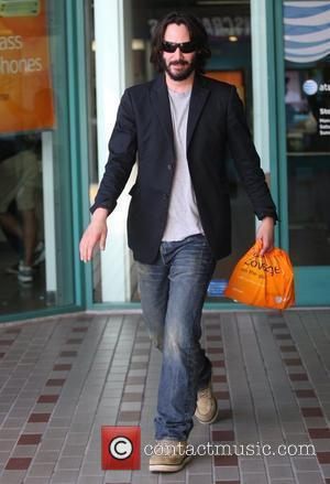Keanu Reeves shopping at an AT&T store for a new cellphone while sporting a bushy beard Los Angeles, California -...