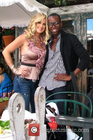 Kim Zolciak and a fan 'The Real Housewives of Atlanta' star Kim Zolciak having lunch at the Ivy Los Angeles,...