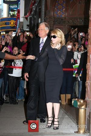 David Letterman welcomes Madonna outside Ed Sullivan Theatre for the 'Late Show With David Letterman' New York City, USA -...