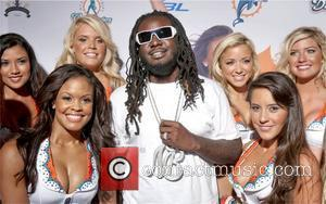 T-Pain and the Miami Dolphins Cheerleaders Miami Dolphins Cheerleaders Unveil 2010 Swimsuit Calendar with their annual fashion show at Casa...