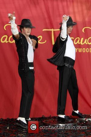 Michael Jackson impersonator Joby Rogers poses with a wax figure of Michael Jackson at Madame Tussauds in Hollywood, California, during...