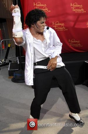Michael Jackson impersonator Joby Rogers performs prior to the unveiling of a wax figure of Michael Jackson at Madame Tussauds...