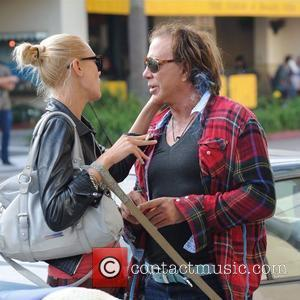 Mickey Rourke shares an intimate moment with a friend Los Angeles, California - 07.11.09