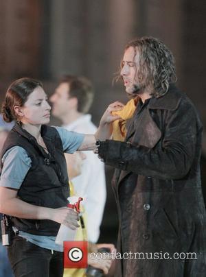 Nicolas Cage and Monica Bellucci film a romantic scene in The Sorcerer's Apprentice at a park in Manhattan. BSC.MWD.ZO7