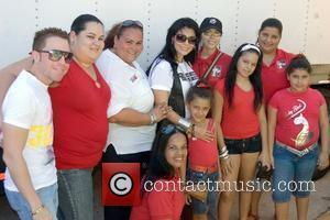 Latin singer Olga Tanon filming a music video with merengue group GrupoMania Santurce, Puerto Rico - 26.09.09