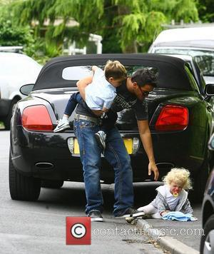Peter Andre, with his children Princess Tiaamii and Junior moving into his new house following the break up of his...