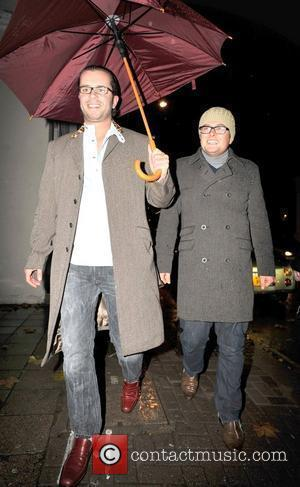 Alan Carr and guest The Prince's Rain Forest reception. London, England - 12.11.09