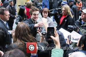 'Twilight' hunk Robert Pattinson signs autographs for fans outside the NBC studios after appearing on 'The Today Show' New York...