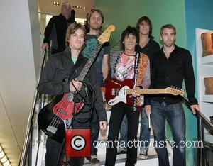 Ronnie Wood with his son Jesse's band 'Black Swan' at BT2 in Grafton Street as part of the Arthur Day...
