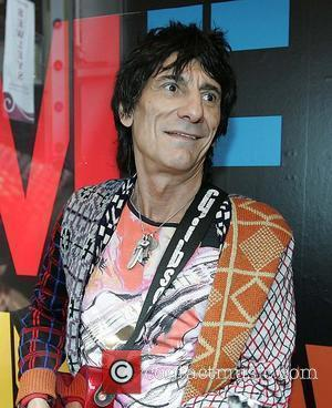 Ronnie Wood playing with his son Jesse's band 'Black Swan' at BT2 in Grafton Street as part of the Arthur...