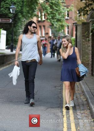 Russell Brand and Laura Gallacher go shopping in Hampstead and then return to his home London, England 09.08.09