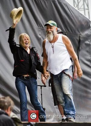 Seasick Steve pulls a fan out of the crowd T in the Park 2009 - Day 3 Kinross, Scotland -...