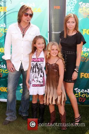 Cyrus Stars In Idol Rogers' Christmas Movie