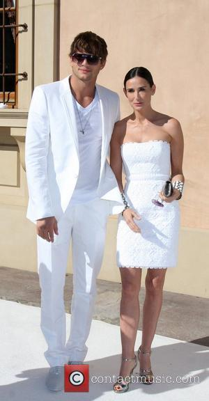 Ashton Kutcher, Demi Moore The Annual White Party held at a private residence in Beverly Hills - Arrivals California, USA...