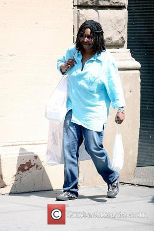 Whoopi Goldberg leaving the Apple Store in SoHo carrying all of her purchases New York City, USA - 19.08.09