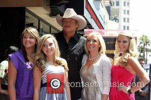 Alan Jackson and his family, daughter Mattie Jackson, daughter Dani Jackson, wife Denise Jackson and daughter Ali Jackson is honoured...