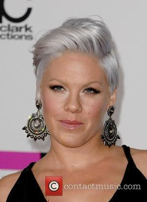 Pregnant Pink Purchases New Family Home