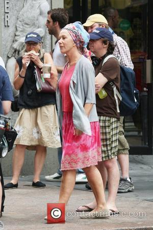 Mirren Buys Charity Clothes For Holidays