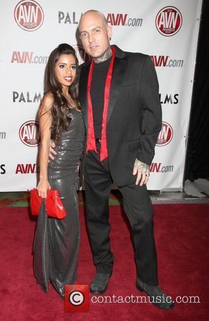 Lupe Fuentes and Evan Seinfeld The AVN Awards 2011 held at the Palms Casino Resort - Arrivals Las Vegas, Nevada...