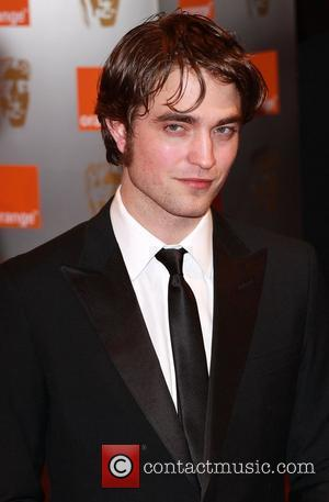 Pattinson & Stewart Enjoy Date At London Gig