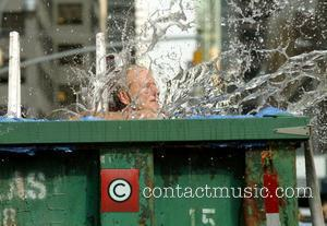 Bill Murray splashing into a makeshift pool  while filming a segment outside The Ed Sullivan Theater for the 'Late...