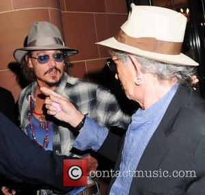 Johnny Depp and Keith Richards both wearing fedora hats and sunglasses, leave at C London restaurant London, England - 15.09.10