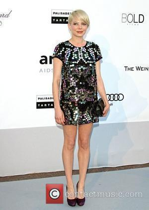 Michelle Williams  2010 Cannes International Film Festival - Day 9 - amfAR's Cinema Against AIDS Gala - Arrivals...