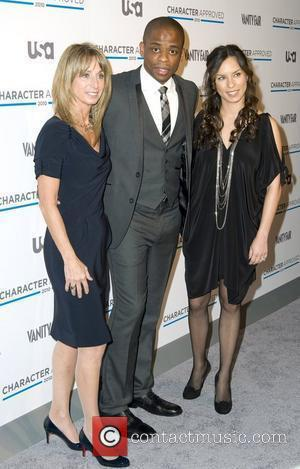 Dule Hill, Bonnie Hammer and guest The 2nd annual Character Approved Awards cocktail reception at The IAC Building New York...