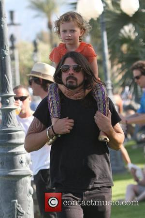 Dave Grohl, with daughter Violet Maye Grohl, on his shoulders at the 2010 Coachella Valley Music and Arts Festival -...