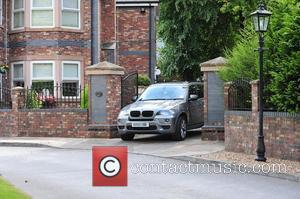 A car leaving Coleen Rooney's parents house. It is rumoured she remains inside the property following revelations about her husband's...