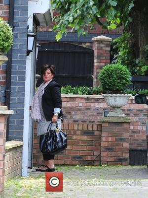 Colette McLoughlin, mother of Coleen Rooney, outside her house. It is rumoured her daughter remains inside the property following revelations...
