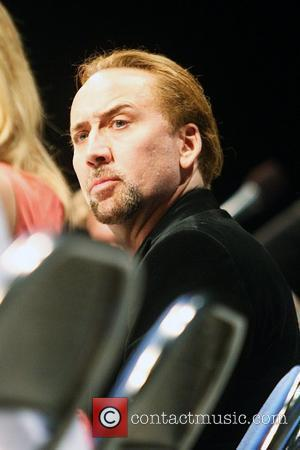 Cage Starts Paying Back Taxes Owed