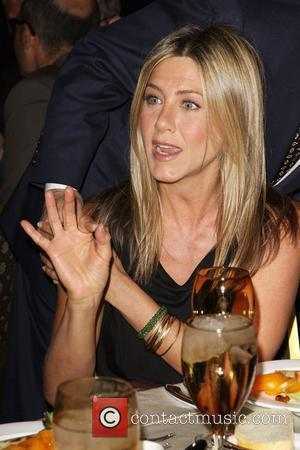 Aniston Ditching Good Girl Image With Movie Strip