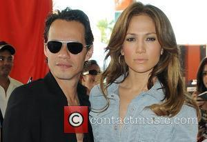 Marc Anthony and Jennifer Lopez appear on the Orange Carpet prior to the Miami Dolphins vs Houston Texans football game...