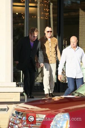 Sir Elton & Furnish Welcome Baby Boy