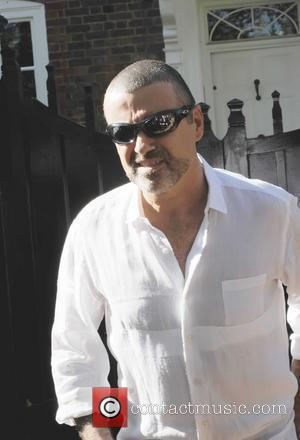George Michael Quizzed Over Car Smash