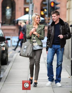 Steven Gerrard and Alex Curran  return to their vehicle after the Liverpool footballer's Jaguar car was parked illegally and...
