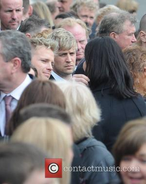 Nicky Byrne, Kian Egan The funeral of RTE broadcaster Gerry Ryan at the Church of St. John the Baptist, Clontarf,...