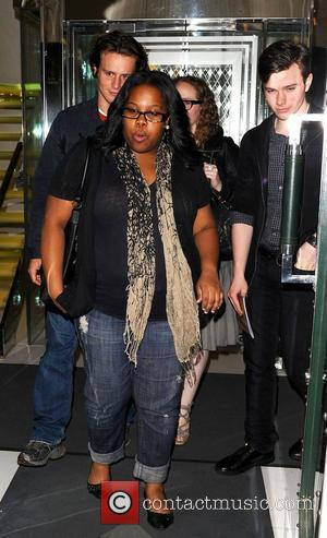 Jonathan Groff, Amber Riley and Chris Colfer (right) of Glee leaving the Ivy London, England - 16.06.10