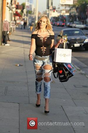 Playboy model Jenna Bentley films a pilot for her new reality show at various boutiques on Melrose Ave. Los Angeles,...
