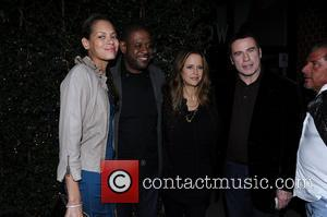 Kelly Preston and John Travolta posing for photos outside Mr Chow restaurant with Forest Whitaker and his wife Keisha Nash...