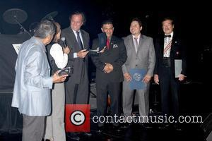Julio Iglesias (3rd L) receives the 'Maximum Hispanic Pride' award from the Las Vegas International Press Association and named today...